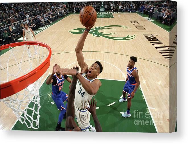 Nba Pro Basketball Canvas Print featuring the photograph New York Knicks V Milwaukee Bucks by Gary Dineen