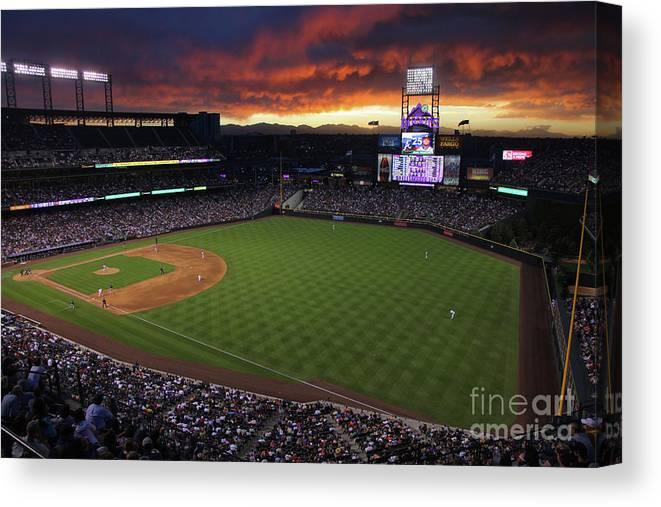 National League Baseball Canvas Print featuring the photograph Atlanta Braves V Colorado Rockies by Doug Pensinger
