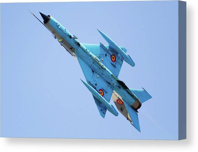 Military Airplane Canvas Print featuring the photograph A Romanian Air Force Mig-21 Mf Lancer-c by Anton Balakchiev/stocktrek Images