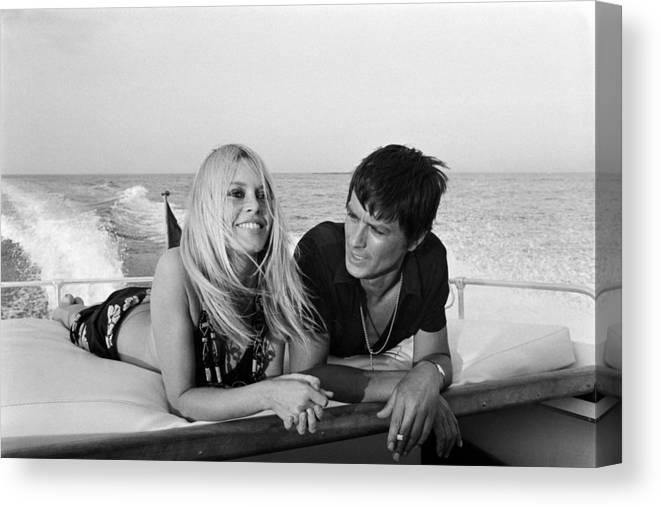 Alain Delon Canvas Print featuring the photograph Alain Delon And Brigitte Bardot In by Jean-pierre Bonnotte