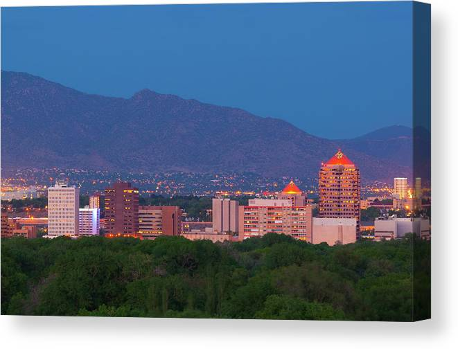 Downtown District Canvas Print featuring the photograph Albuquerque Skyline At Dusk by Davel5957