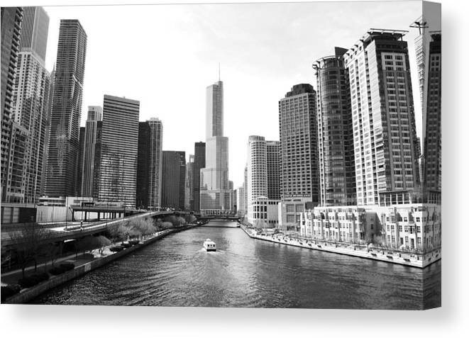 Chicago River Canvas Print featuring the photograph An Unknown Skyline Along The Chicago by Ricardo Montiel