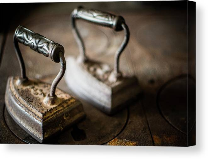 Two Objects Canvas Print featuring the photograph Antique Irons by Jimss