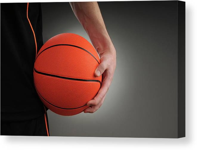People Canvas Print featuring the photograph Basketball Player by Mumininan
