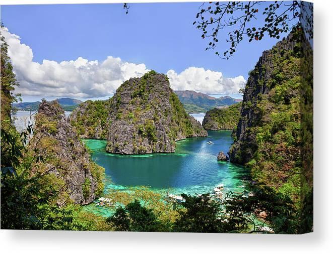 Scenics Canvas Print featuring the photograph Beautiful Blue Lagoon At Kayangan Lake by Fototrav