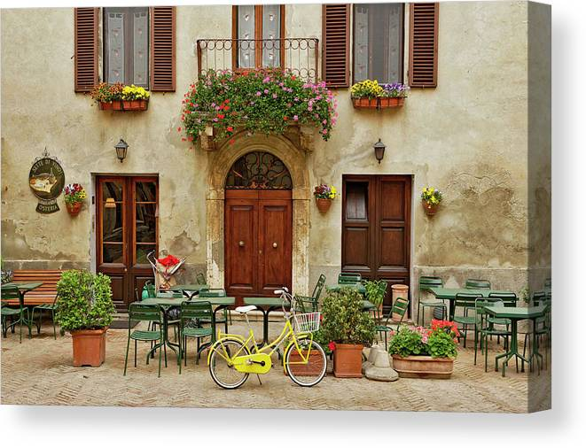 Pienza Canvas Print featuring the photograph Bicycle In Front Of Small Cafe, Tuscany by Adam Jones