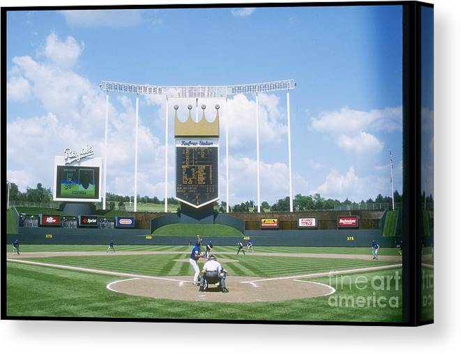 American League Baseball Canvas Print featuring the photograph Blue Jays V Royals by Stephen Dunn