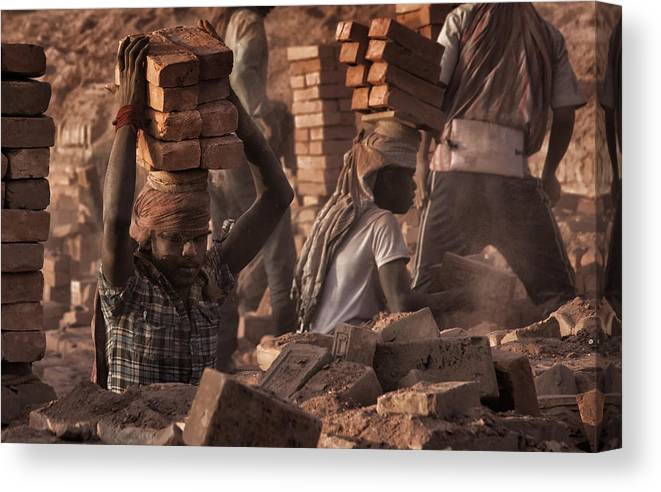 Nepal Canvas Print featuring the photograph Brick Factory (2): Workers Stacking Bricks by Yvette Depaepe
