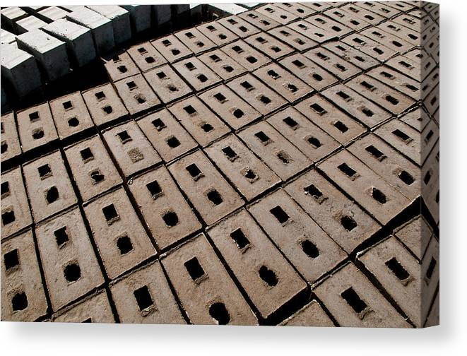 In A Row Canvas Print featuring the photograph Bricks Of Mud To Be Dried by Marco Vacca