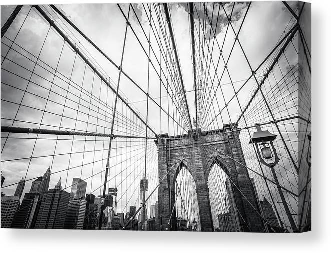 Downtown District Canvas Print featuring the photograph Brooklyn Bridge And New York Skyline by Cirano83