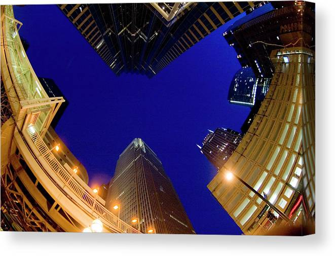 Clear Sky Canvas Print featuring the photograph Buildings, Low Angle View by By Ken Ilio