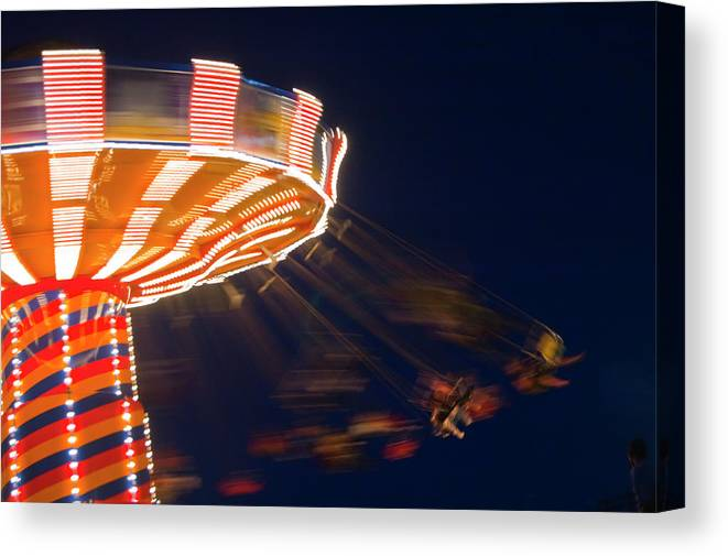 Blurred Motion Canvas Print featuring the photograph Carnival Ride by By Ken Ilio