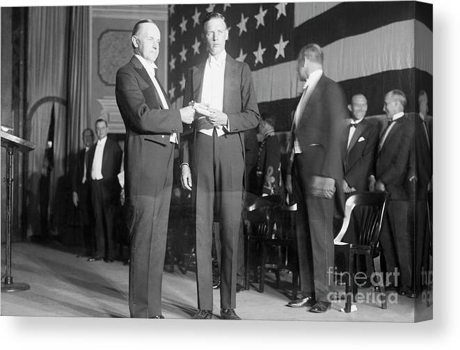 Mature Adult Canvas Print featuring the photograph Charles Lindbergh Receiving Hubbard by Bettmann