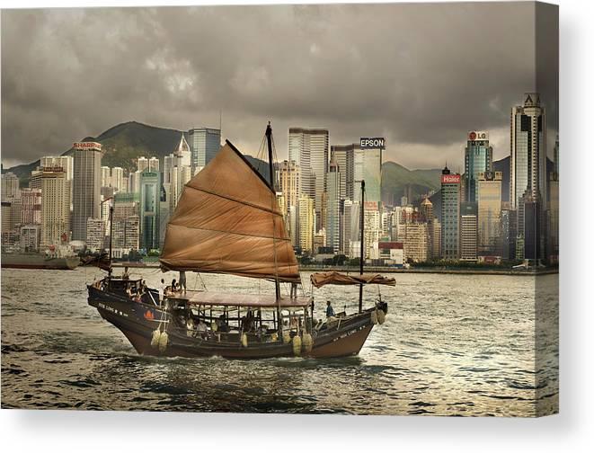 Sailboat Canvas Print featuring the photograph China, Hong Kong, Junk Boat In Bay by Maremagnum