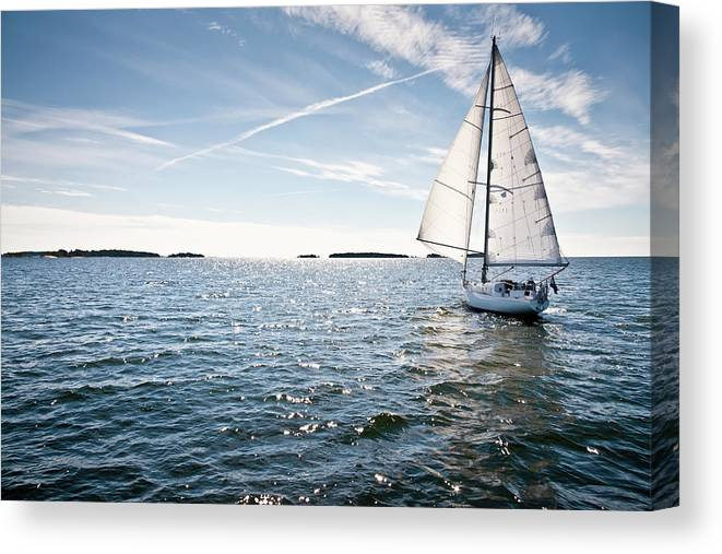 Recreational Pursuit Canvas Print featuring the photograph Classic Yacht Sailing Away Against Blue by Jaap-willem