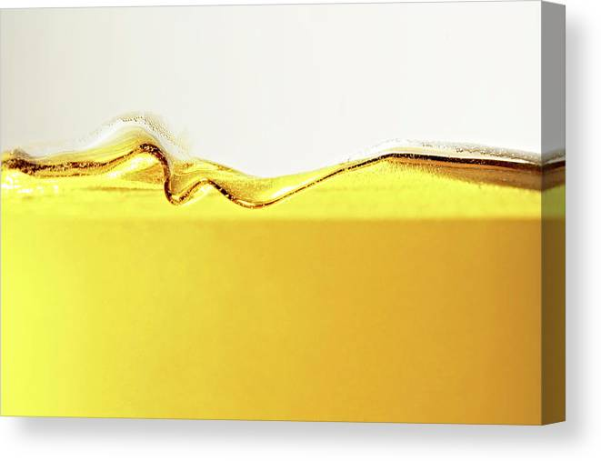 Motion Canvas Print featuring the photograph Close Up Of Oil In Glass by Cwp
