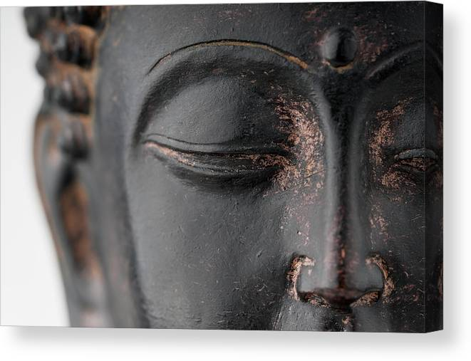 Statue Canvas Print featuring the photograph Closeup Of Black Stone Buddha Face by Wesvandinter