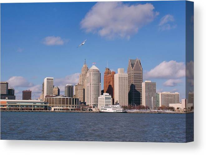 Downtown District Canvas Print featuring the photograph Cold Detroit by Corfoto
