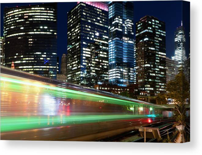 Passenger Train Canvas Print featuring the photograph Commuter Train In Downtown Chicago by Chrisp0