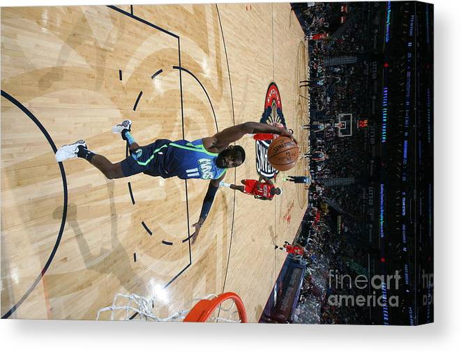 Tim Hardaway Jr. Canvas Print featuring the photograph Dallas Mavericks V New Orleans Pelicans by Layne Murdoch Jr.