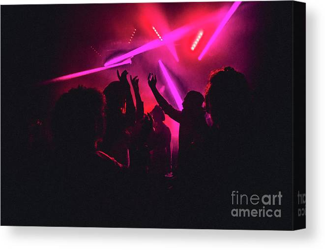 Young Men Canvas Print featuring the photograph Dancing The Night Away by Solstock
