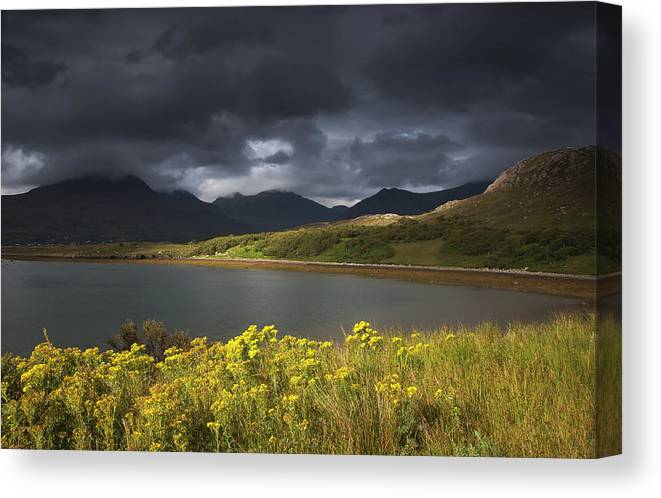 Tranquility Canvas Print featuring the photograph Dark Storm Clouds Hang Over The by John Short / Design Pics