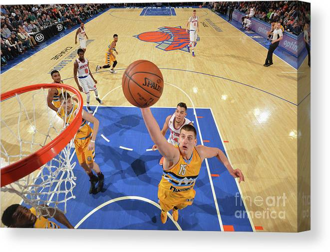 Nba Pro Basketball Canvas Print featuring the photograph Denver Nuggets V New York Knicks by Jesse D. Garrabrant