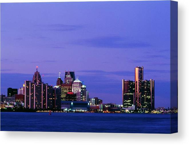 Downtown District Canvas Print featuring the photograph Detroit Skyline At Night In Usa by Design Pics