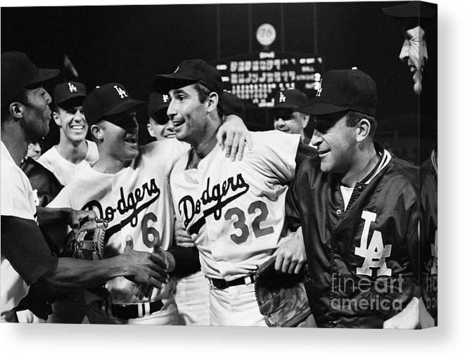 Sandy Koufax Canvas Print featuring the photograph Dodgers Congratulating Sandy Koufax by Bettmann