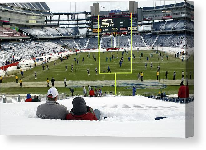 Snow Canvas Print featuring the photograph Dolphins V Patriots by Ezra Shaw