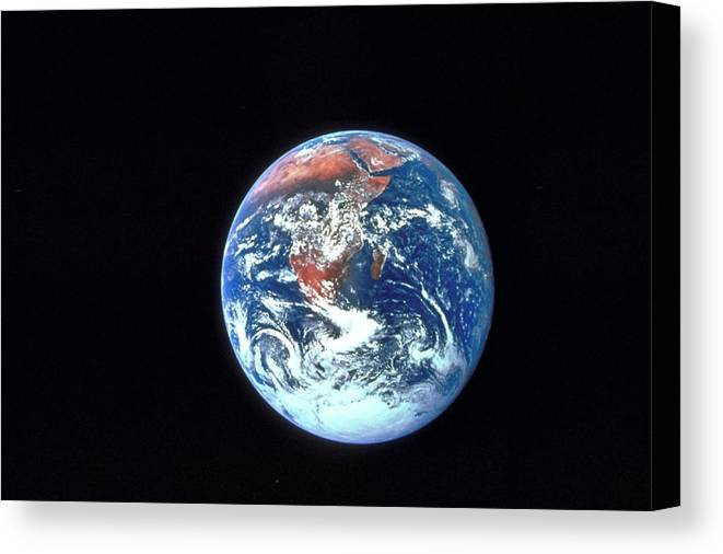 Globe Canvas Print featuring the photograph Earth From Outer Space by Ablestock.com