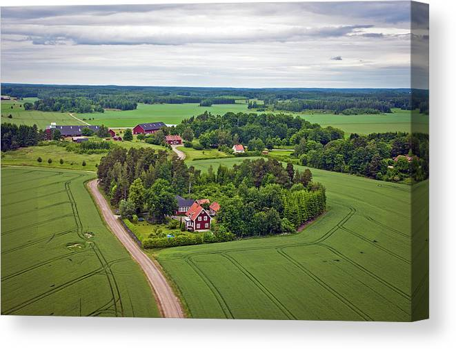 Scenics Canvas Print featuring the photograph Farms And Fields In Sweden North Europe by Pavliha