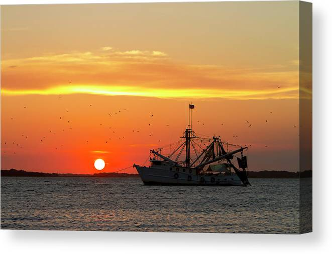 Water's Edge Canvas Print featuring the photograph Fishing Boat At Sunset by Tshortell