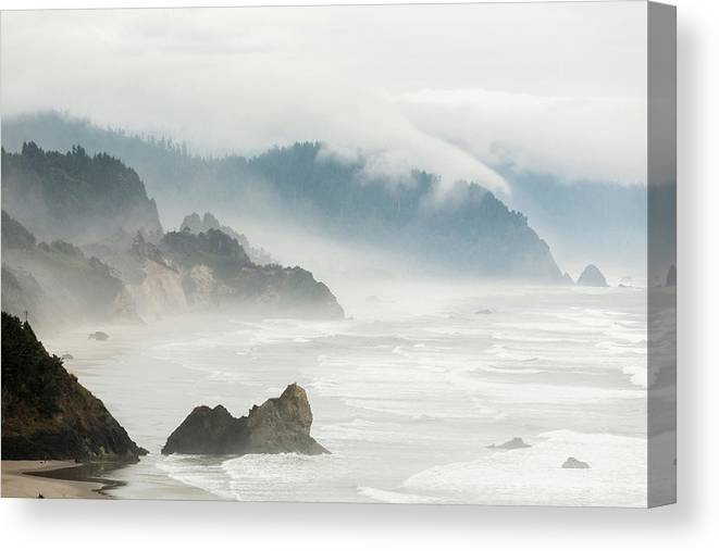 Scenics Canvas Print featuring the photograph Fog Shrouded View Of Rocky Coastline by Win-initiative