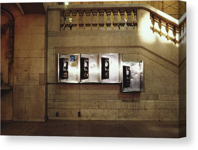 Pay Phone Canvas Print featuring the photograph Four Telephone Booths On Marble Wall by Herb Schmitz