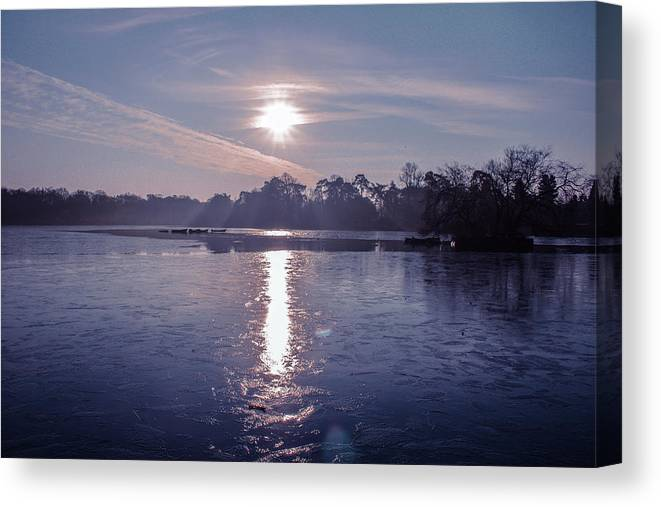 Lake Canvas Print featuring the photograph Frozen by Claire Lowe