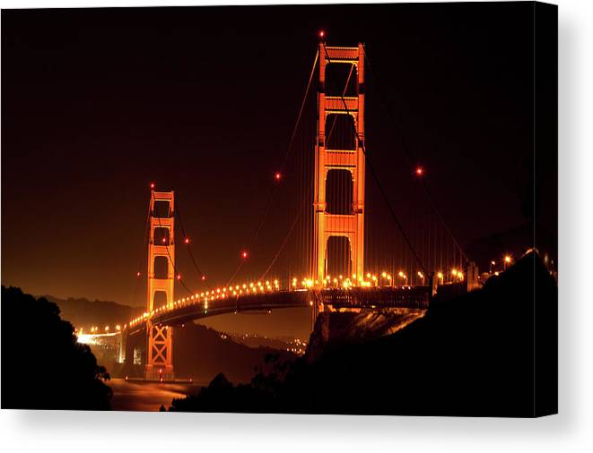 Scenics Canvas Print featuring the photograph Golden Gate Bridge At Night by Imaginegolf