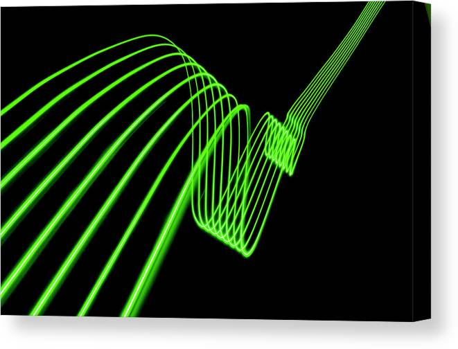 Laser Canvas Print featuring the photograph Green Abstract Coloured Lights Trails by John Rensten