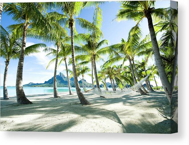 Hanging Canvas Print featuring the photograph Hammock At Bora Bora, Tahiti by Yusuke Okada/amanaimagesrf