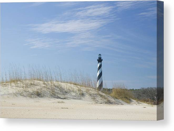 North Carolina Canvas Print featuring the photograph Hatteras Lighthouse And The Dunes by Myhrcat