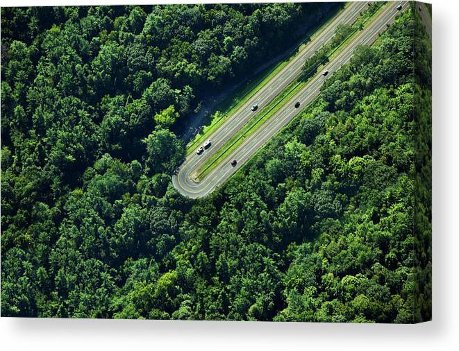 The End Canvas Print featuring the photograph Highway U-turn In Forest by Thomas Jackson