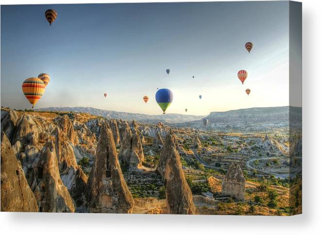 Scenics Canvas Print featuring the photograph Hot-air Balloon Above Cappadocia by Chantal