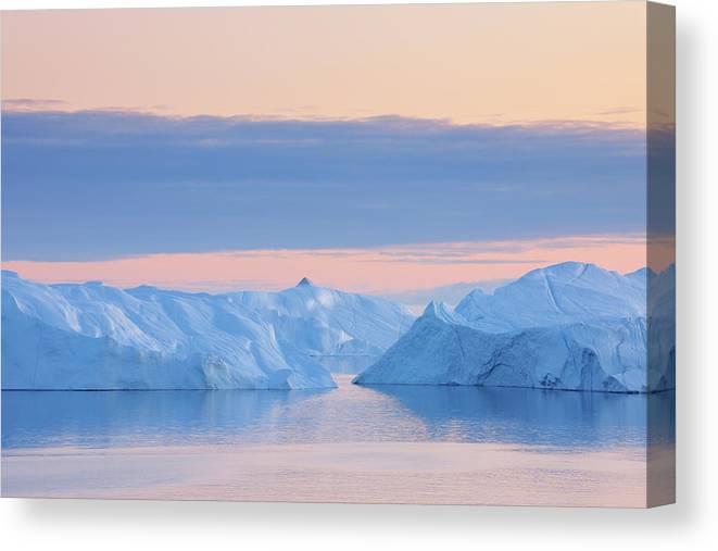 Iceberg Canvas Print featuring the photograph Iceberg by Raimund Linke