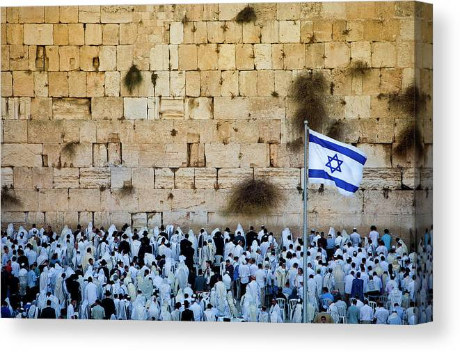 Crowd Canvas Print featuring the photograph Israeli Flag Flies At The Western Wall by Gary S Chapman