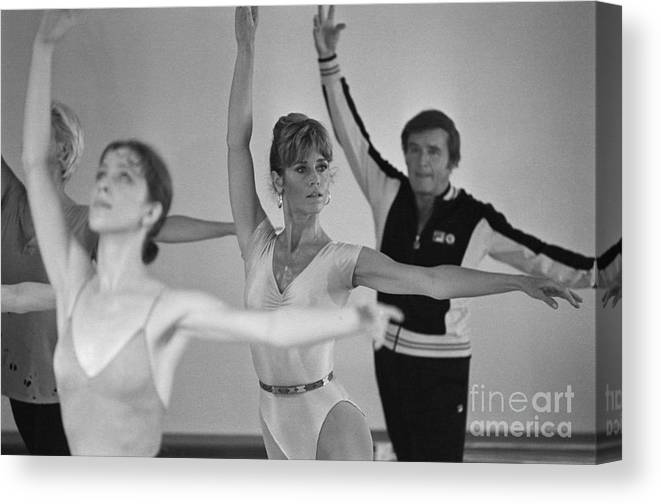 Talkshow Canvas Print featuring the photograph Jane Fonda And Mike Douglas Exercising by Bettmann
