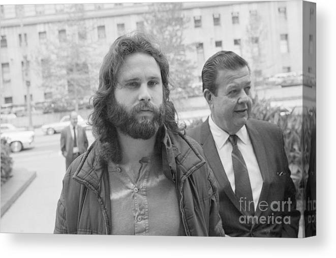 Singer Canvas Print featuring the photograph Jim Morrison Walking To Extradition by Bettmann