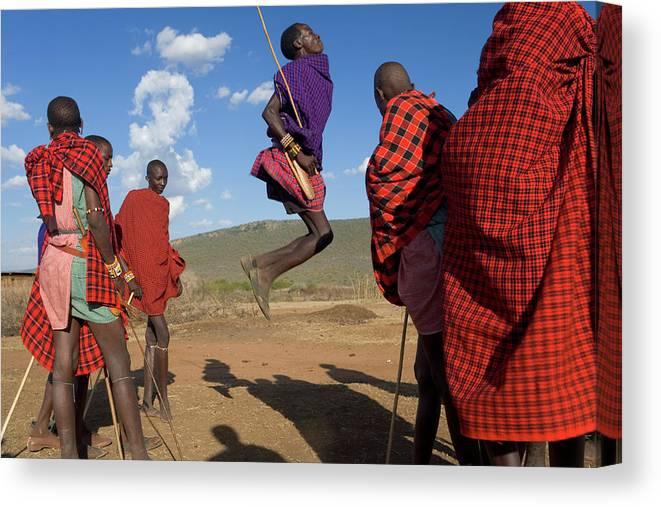 Young Men Canvas Print featuring the photograph Kenya, Masai Mara, Masai Dancers by Peter Adams