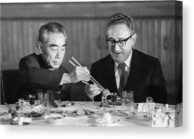 Chinese Culture Canvas Print featuring the photograph Kissinger Eating With Zhou Enlai by Bettmann