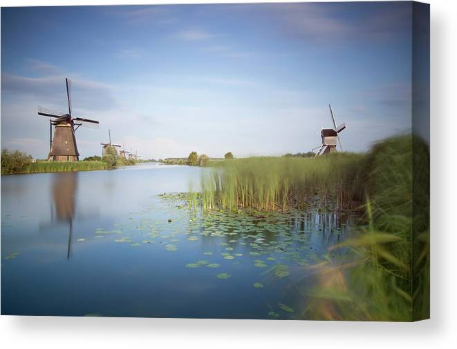 Tranquility Canvas Print featuring the photograph Landscape With Windmills, Kinderdijk by Frank De Luyck