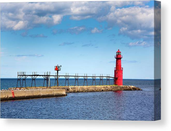 Lake Michigan Canvas Print featuring the photograph Lighthouse And Pier On Lake Michigan by Jamesbrey